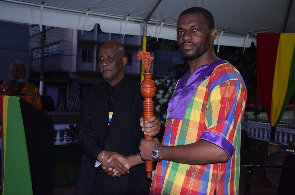 Castries Mayor Peterson Francis passed the CARICOM Reparations Baton to Saint Lucia's CARICOM Youth Ambassador Charde Desir, who is also Dean of the CARICOM Youth Ambassadors.