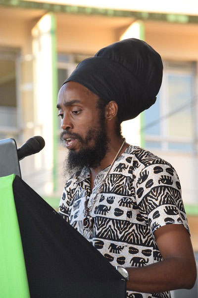 Kwesi I-Shawa Goddard, the Youth Representative of the Iyanola Council for Advancement of Rastafari (ICAR), read a special youth message in Kwéyol language from his tablet, just ahead of the reading of the Declaration of Castries.